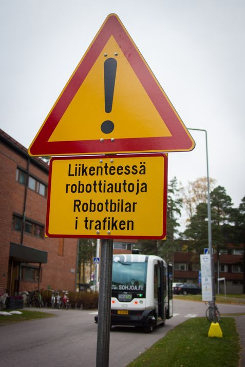 EZ-10 robot bus in Otaniemi, Espoo, Finland with a robot bus warning side in front
